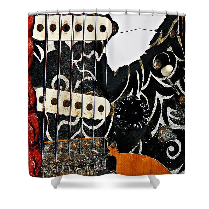 Fender Shower Curtain featuring the photograph An Axe To Grind by Chris Berry