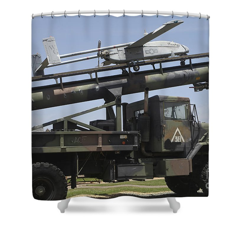 Horizontal Shower Curtain featuring the photograph An Rq-2b Pioneer Uav On An M927 by Timm Ziegenthaler
