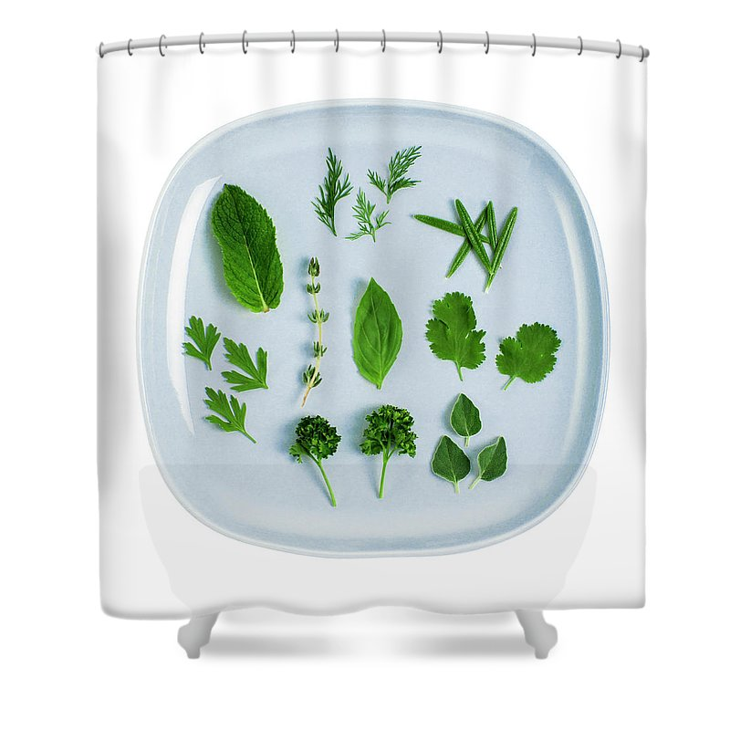 White Background Shower Curtain featuring the photograph Assorted Fresh Herb Leaves On Blue Plate by Creative Crop