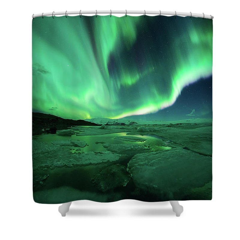Glacier Lagoon Shower Curtain featuring the photograph Aurora Display Over The Glacier Lagoon by Natthawat