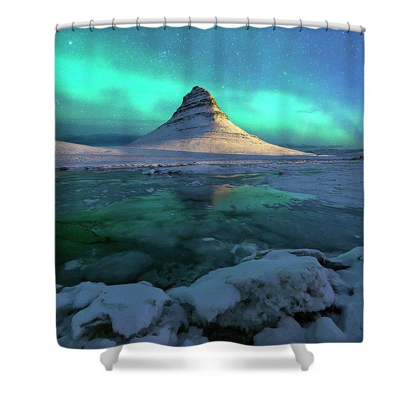 Tranquility Shower Curtain featuring the photograph Aurora Over Kirkjufell Mountain Iceland by Ratnakorn Piyasirisorost