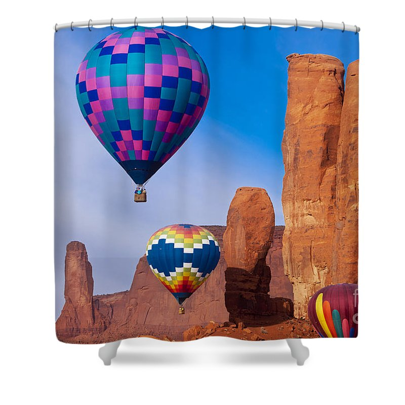 3 Sisters Shower Curtain featuring the photograph Balloon Festival In Monument Valley by Brian Jannsen