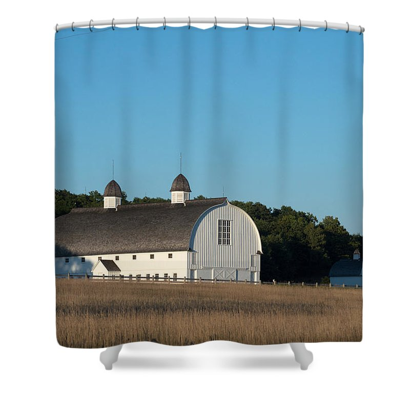 Michigan Shower Curtain featuring the photograph Barn On The Hill by Linda Kerkau