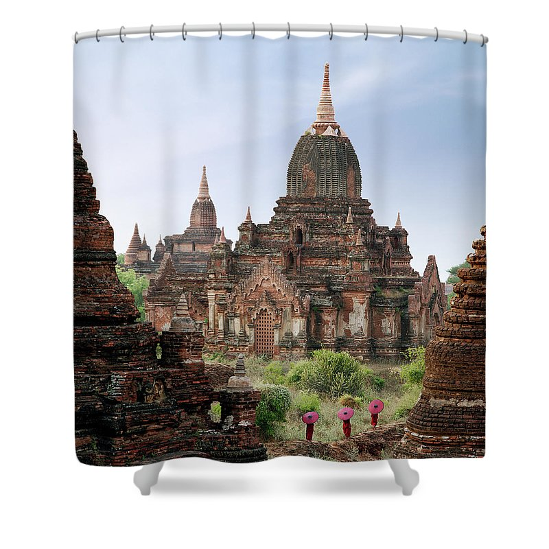 Tranquility Shower Curtain featuring the photograph Buddhist Monks Walking Past Temple by Martin Puddy