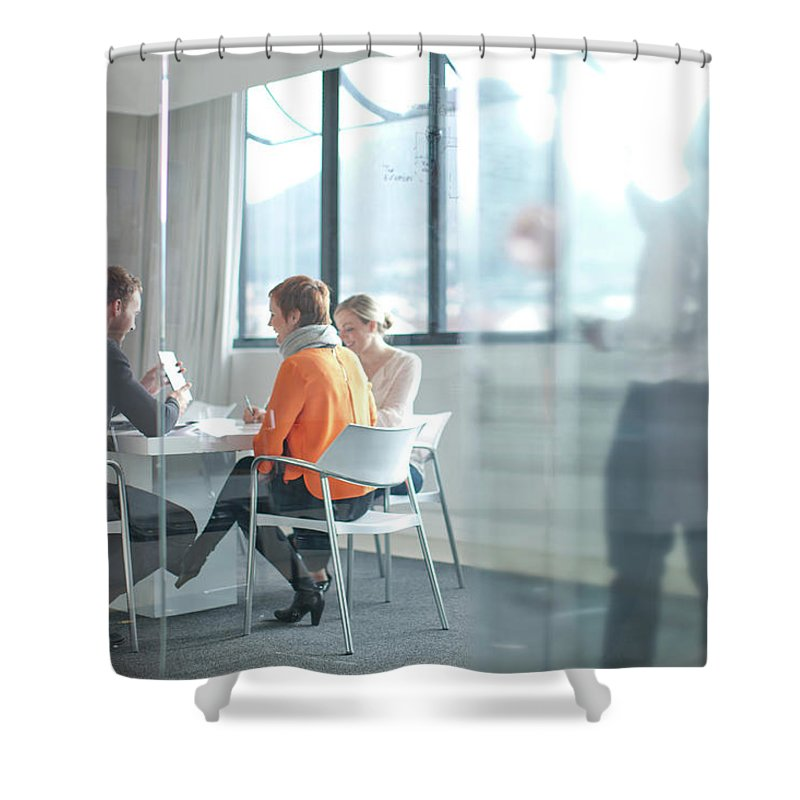 Young Men Shower Curtain featuring the photograph Businesspeople Having Meeting At by Zero Creatives