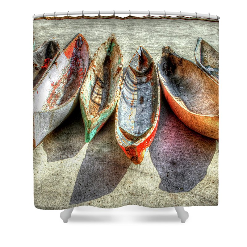 The Shower Curtain featuring the photograph Canoes by Debra and Dave Vanderlaan