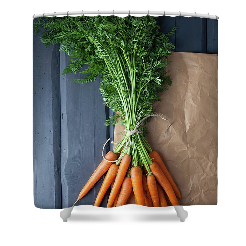 Bunch Shower Curtain featuring the photograph Carrots With Brown Paper On Wooden by Westend61