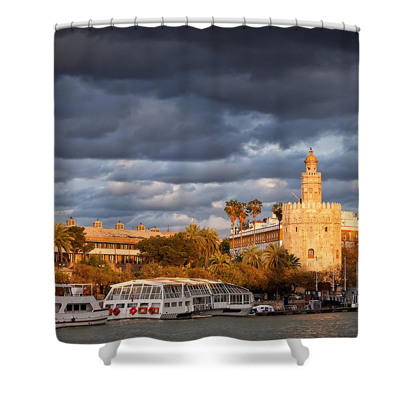 Guadalquivir Shower Curtain featuring the photograph City Of Seville At Sunset by Artur Bogacki