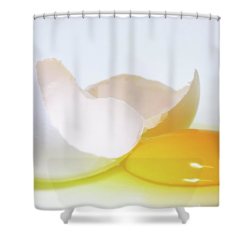 White Background Shower Curtain featuring the photograph Close-up Of A Broken Egg On White by Zen Rial