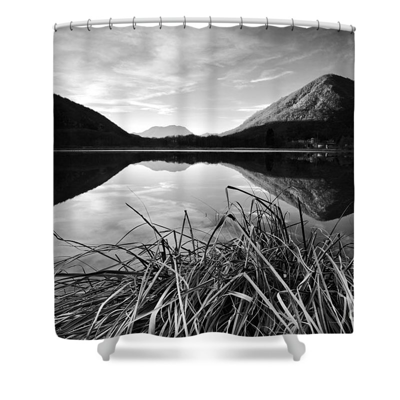 Grass Shower Curtain featuring the photograph Cone Shaped Mountain Reflected In Lake At Sunset by Matteo Colombo