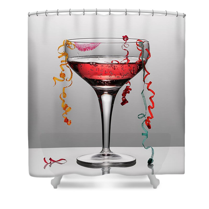 Streamer Shower Curtain featuring the photograph Confetti Hanging From Glass Of Pink by Andy Roberts