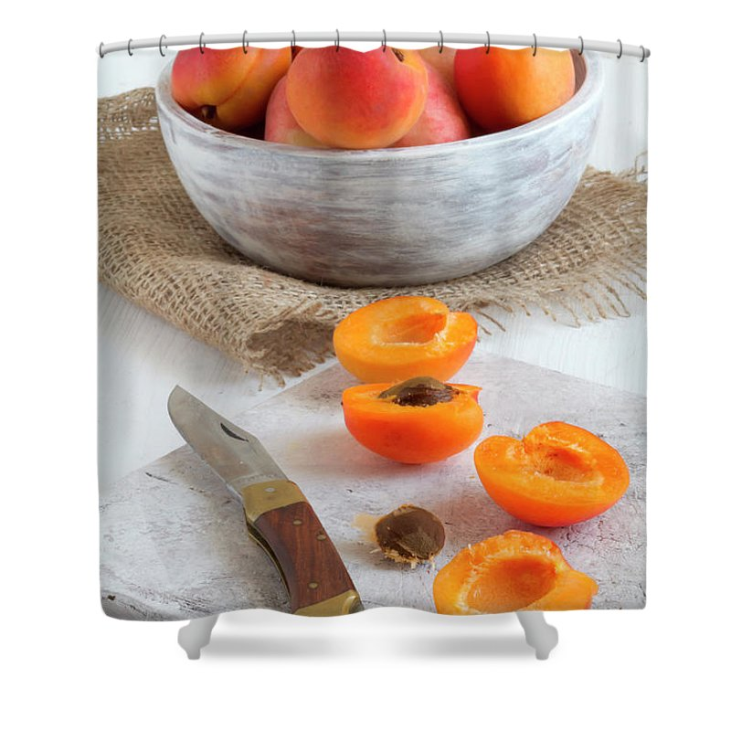 Cutting Board Shower Curtain featuring the photograph Cross Section Apricots With Knife And by Westend61