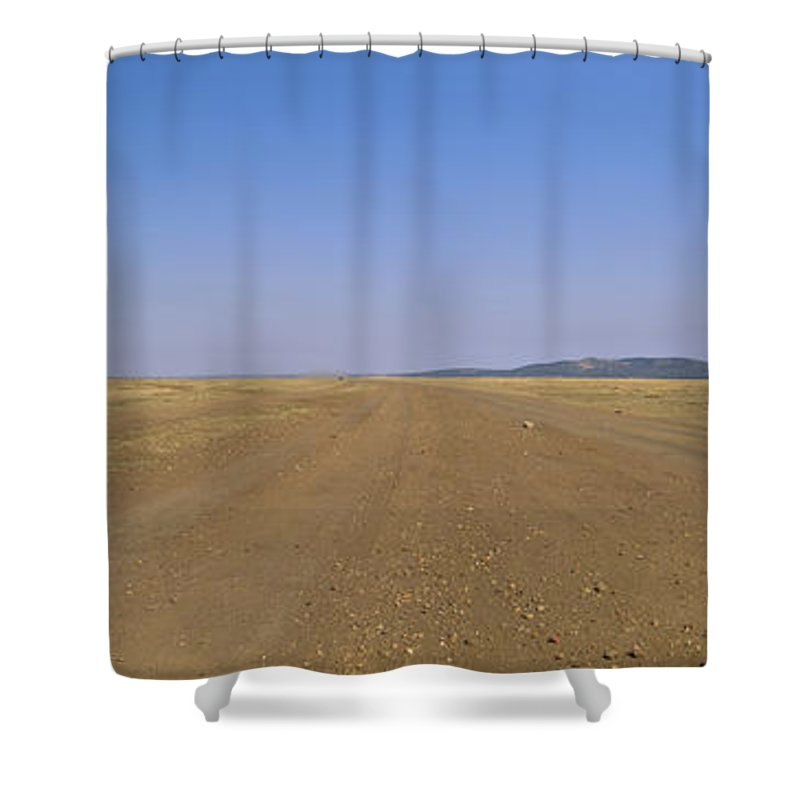 Photography Shower Curtain featuring the photograph Dirt Road Passing Through A Landscape by Panoramic Images