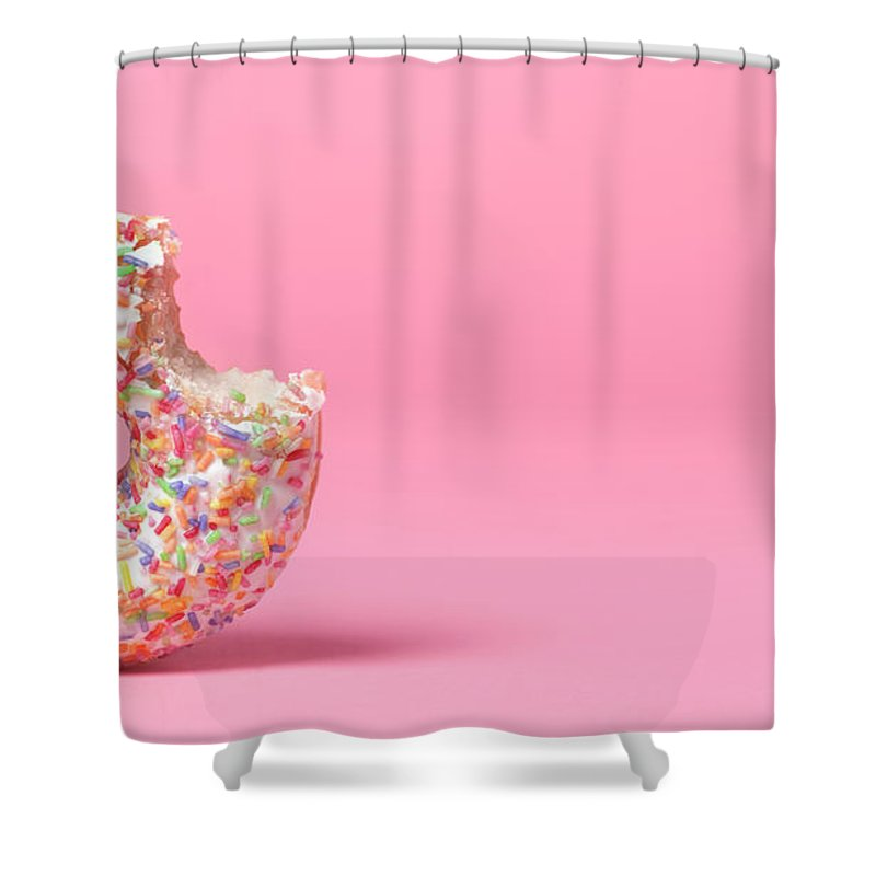 Unhealthy Eating Shower Curtain featuring the photograph Doughnut On Pink With Bite Out by Peter Dazeley