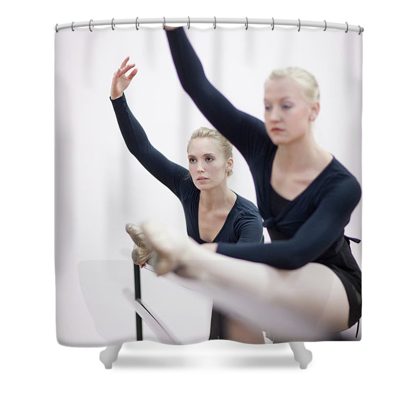 Ballet Dancer Shower Curtain featuring the photograph Female Ballerinas Stretching At The by Zero Creatives