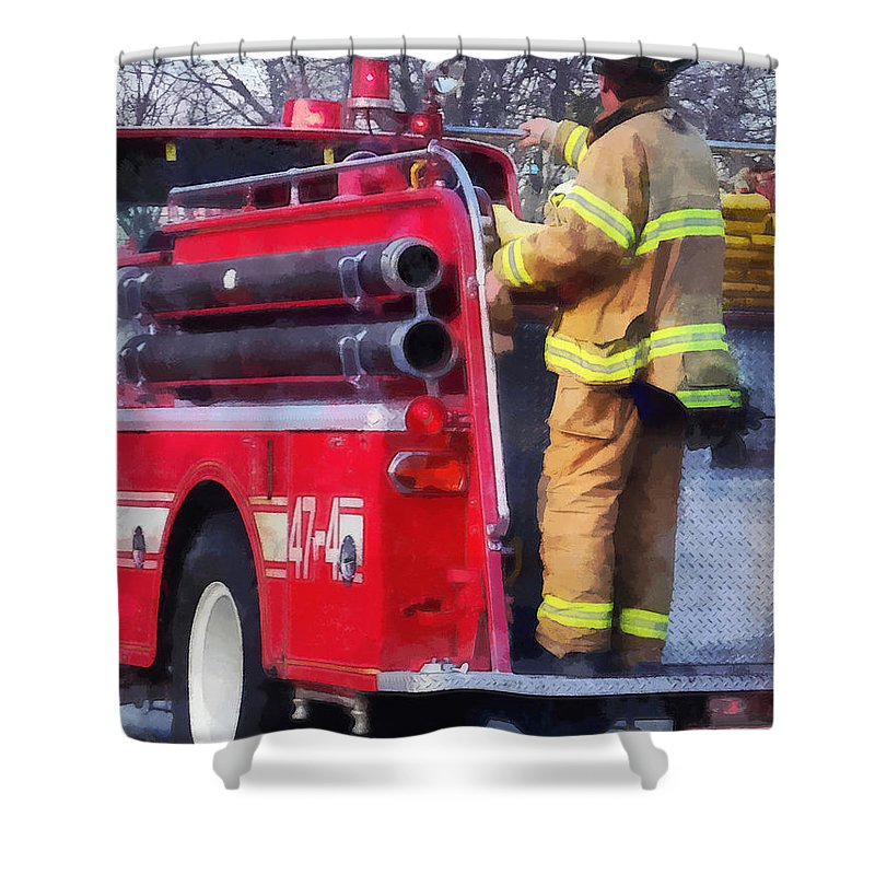 Firefighter Shower Curtain Featuring The Photograph Fireman On Back Of Fire Truck By Susan Savad