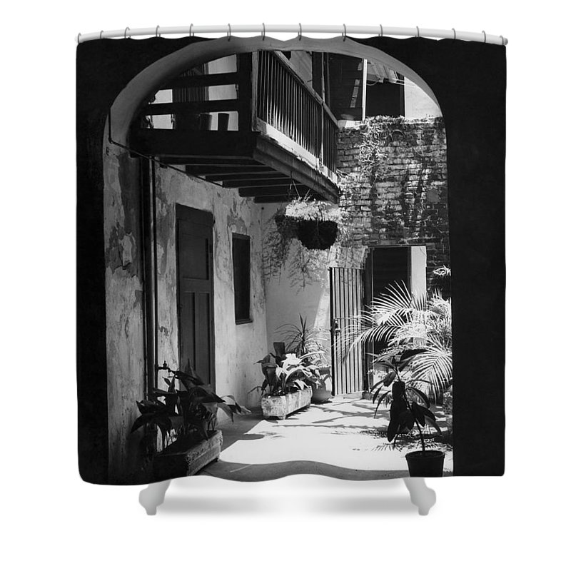 1950s Shower Curtain featuring the photograph French Quarter Courtyard by Underwood Archives