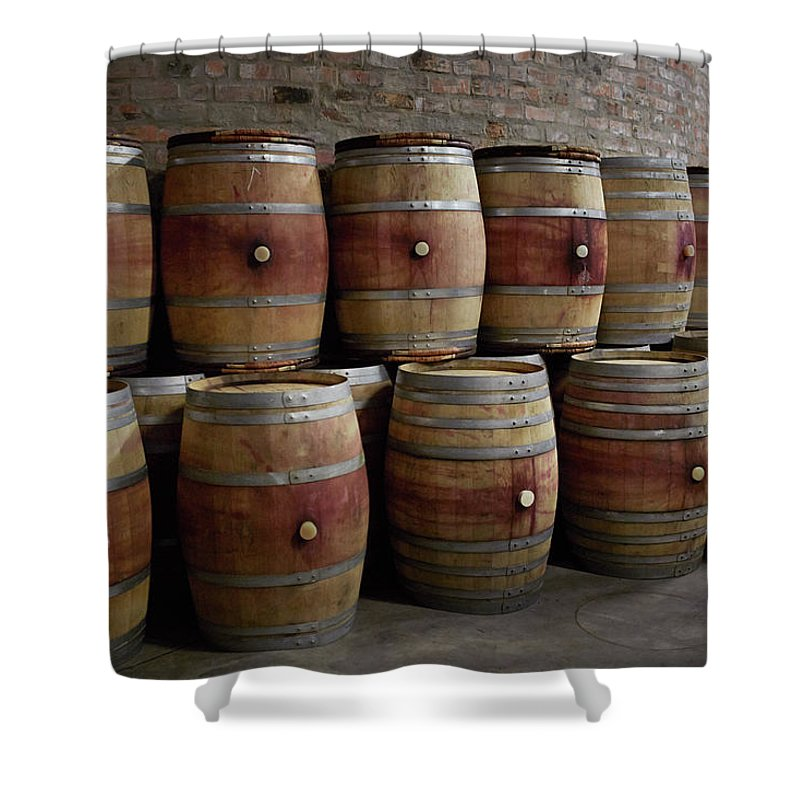 Stellenbosch Shower Curtain featuring the photograph French Wine Barrels Stacked At Winery by Klaus Vedfelt