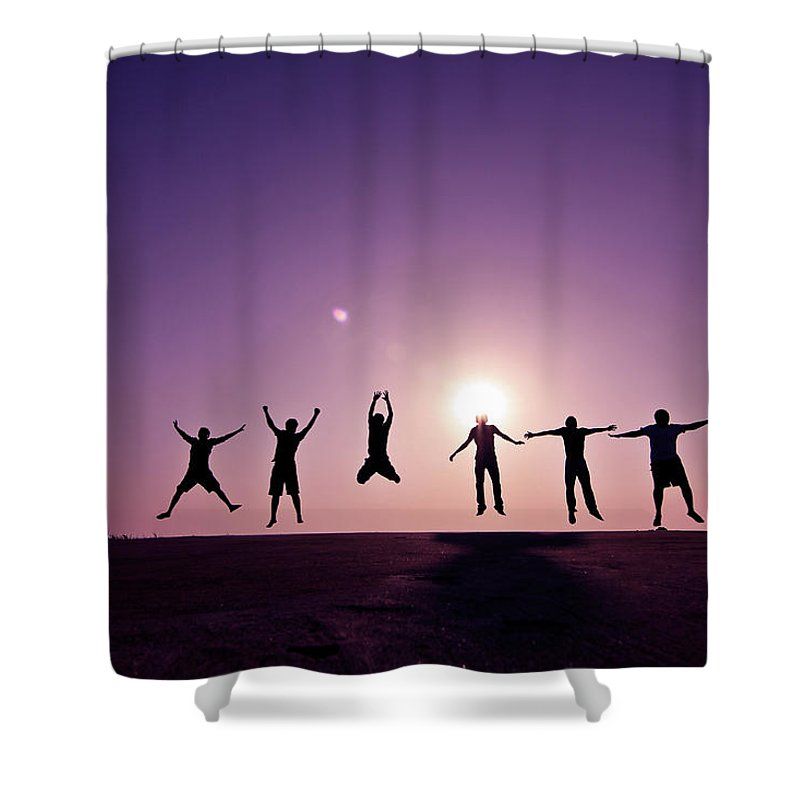 Human Arm Shower Curtain featuring the photograph Friends Jumping Against Sunset by Kazi Sudipto Photography