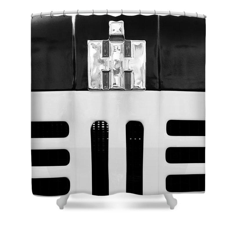 International Grille Emblem Shower Curtain featuring the photograph International Grille Emblem by Jill Reger