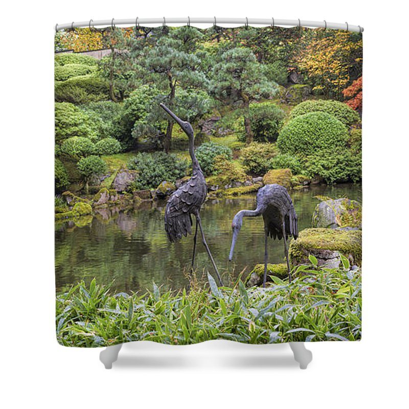 Bronze Shower Curtain featuring the photograph Japanese Bronze Cranes Sculpture By Pond by David Gn