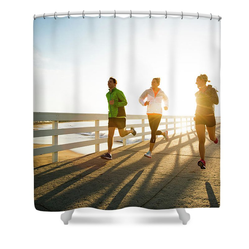 Young Men Shower Curtain featuring the photograph Jogging Along The Coast by Jordan Siemens