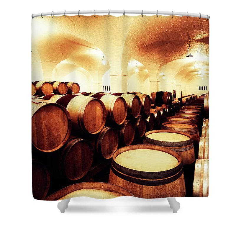 Alcohol Shower Curtain featuring the photograph Large Winery Cellar Filled With Oak by Rapideye