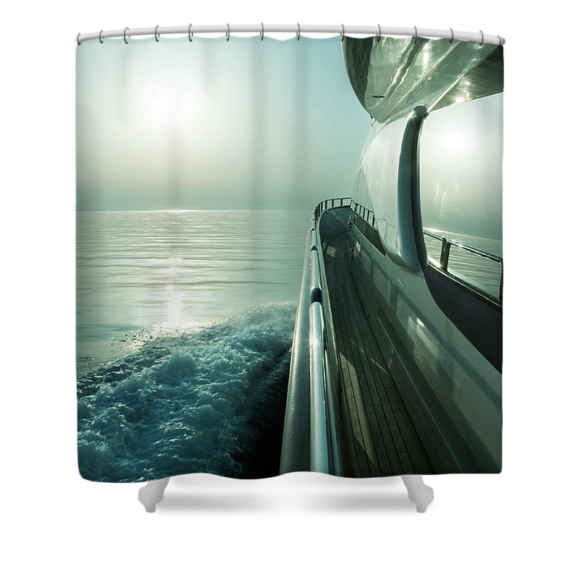 Desaturated Shower Curtain featuring the photograph Luxury Motor Yacht Sailing At Sunset by Petreplesea