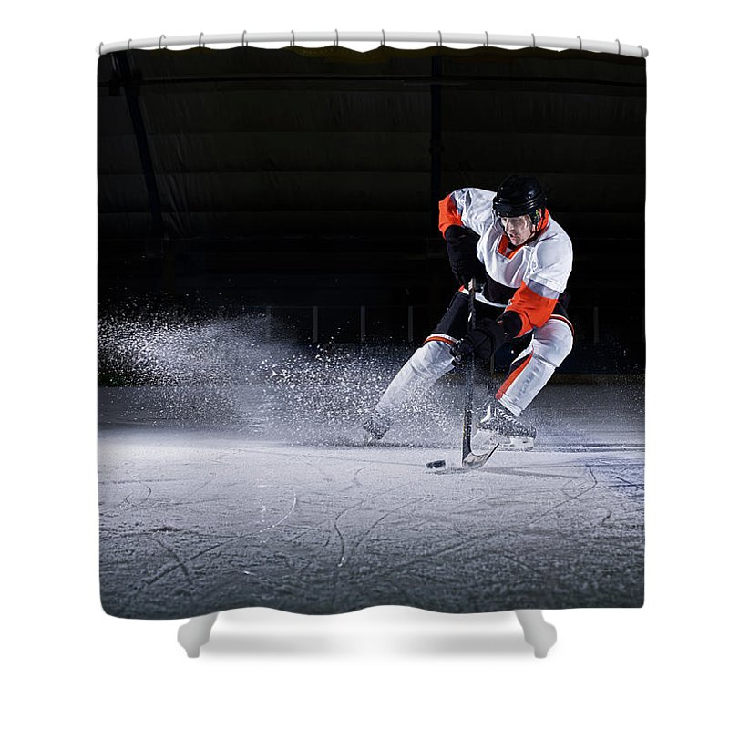 Focus Shower Curtain featuring the photograph Male Ice Hockey Player Taking Puck by Mike Harrington