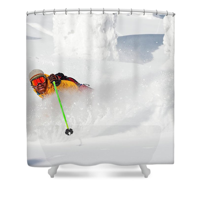 Holding Shower Curtain featuring the photograph Male Skier Makes A Deep Powder Turn by Craig Moore