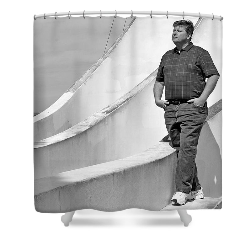 Black Shower Curtain featuring the photograph Man At Conrcete Structure by Bradley Bennett