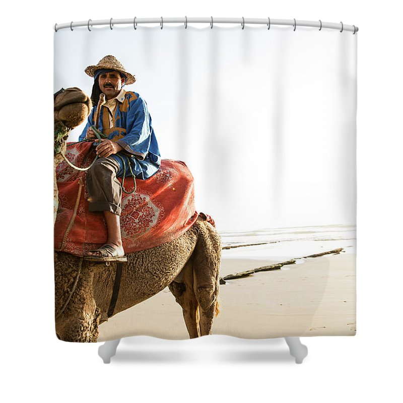 Agadir Shower Curtain featuring the photograph Man On Camel On Beach, Taghazout by Tim E White