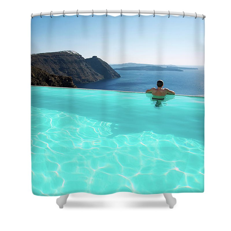People Shower Curtain featuring the photograph Man Relaxing Looking At Santorini by Peskymonkey