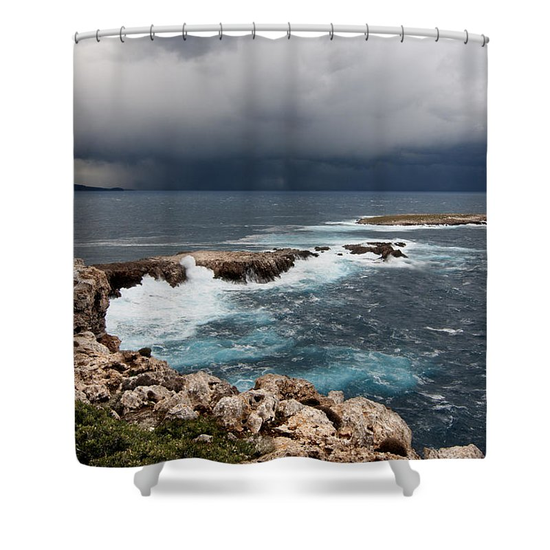 Abstract Shower Curtain featuring the photograph Wild Rocks At North Coast Of Minorca In Middle Of A Wild Sea With Stormy Clouds by Pedro Cardona Llambias