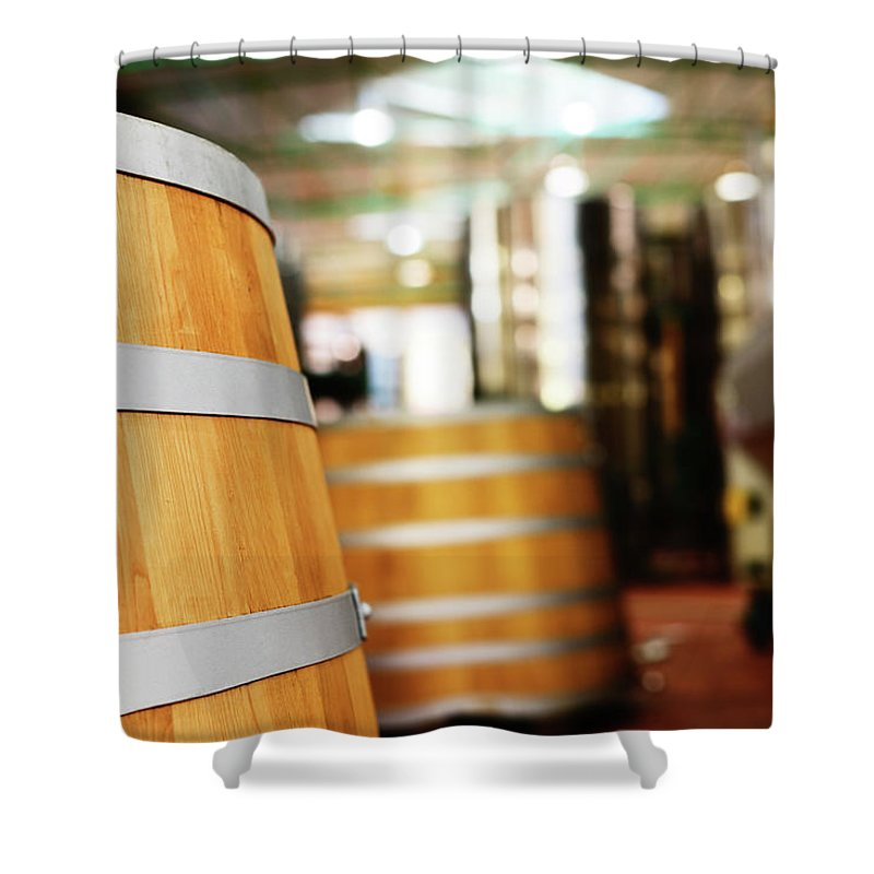 Alcohol Shower Curtain featuring the photograph Oak Barrels And Winemaking Equipment In by Rapideye