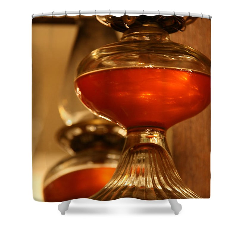 Hippo Hardware Shower Curtain featuring the photograph Oil Lamp In Red by Elizabeth Rose