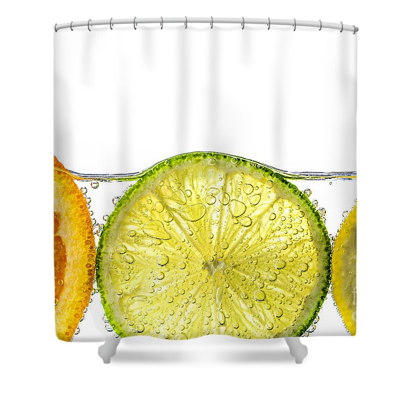 Orange Shower Curtain Featuring The Photograph Lemon And Lime Slices In Water By Elena Elisseeva