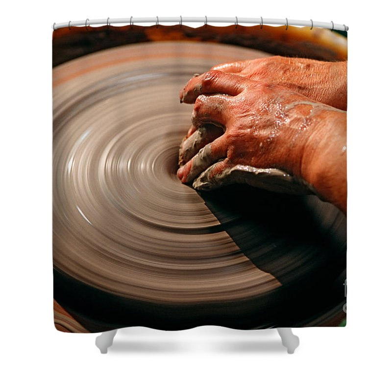 Hand Shower Curtain featuring the photograph Smoothing Clay by James L. Amos