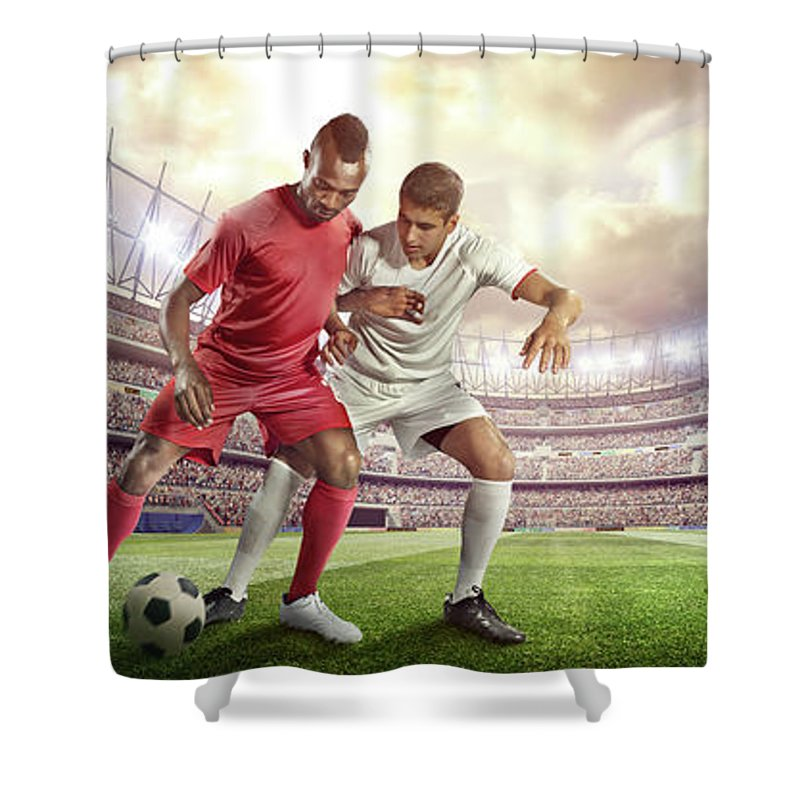 Soccer Uniform Shower Curtain featuring the photograph Soccer Player Tackling Ball In Stadium by Dmytro Aksonov