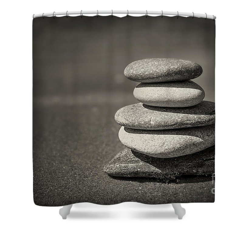 Rock Shower Curtain featuring the photograph Stacked pebbles on beach by Elena Elisseeva