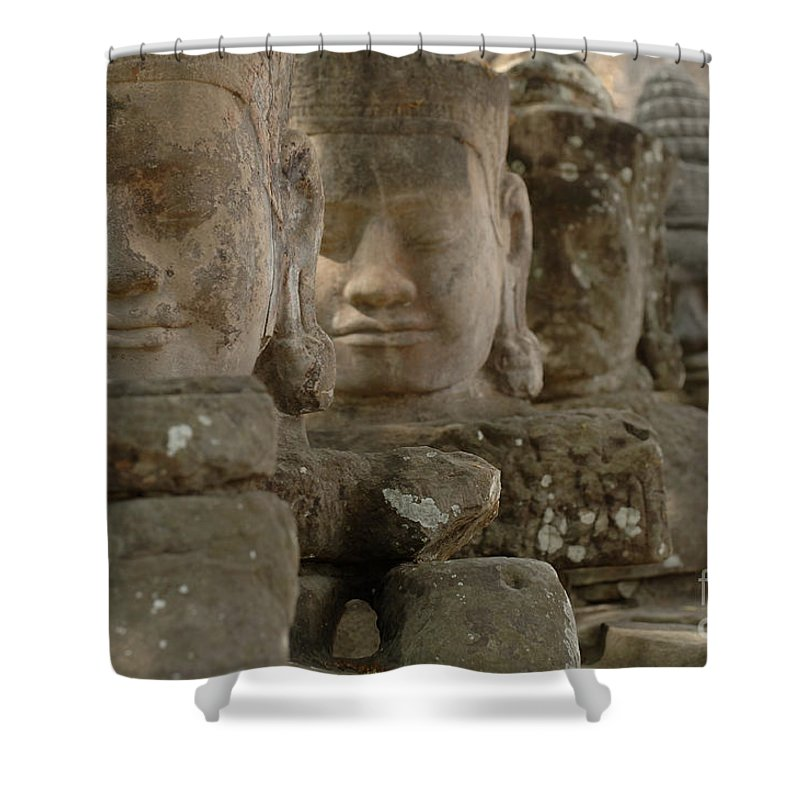 Cambodian Youth Shower Curtain featuring the photograph Stone Figures Cambodia by Bob Christopher