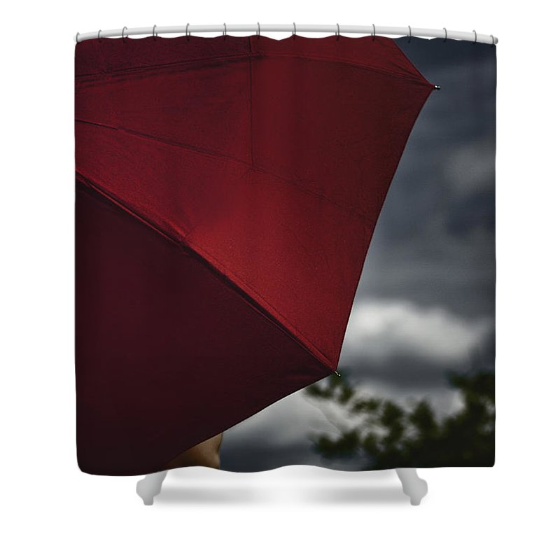 Caucasian; Woman; Female; Lady; Bright; Color; Red; Umbrella; Back; Holding; Outside; Outdoors; Storm; Stormy; Clouds; Sky; Dark; Ominous; Foreboding; Tree; Cropped; Summer; Spring; Covered; Protection Shower Curtain featuring the photograph Stormy by Margie Hurwich