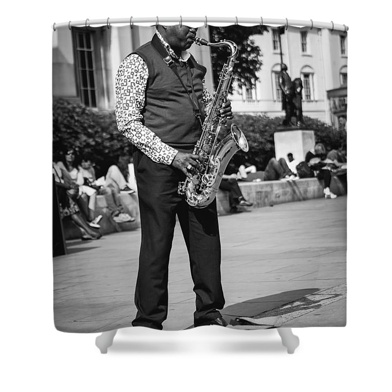 Street Musician Shower Curtain featuring the photograph Street Musician by Jimmy Karlsson