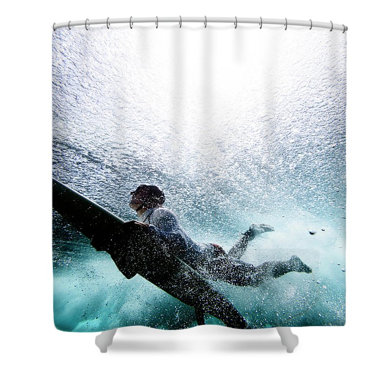 Expertise Shower Curtain featuring the photograph Surfer Duck Diving by Subman