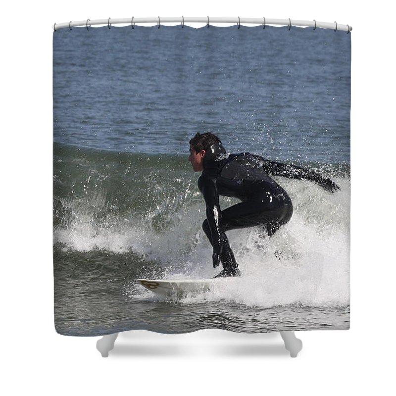 Surfer Hitting The Curl Shower Curtain featuring the photograph Surfer Hitting The Curl by John Telfer