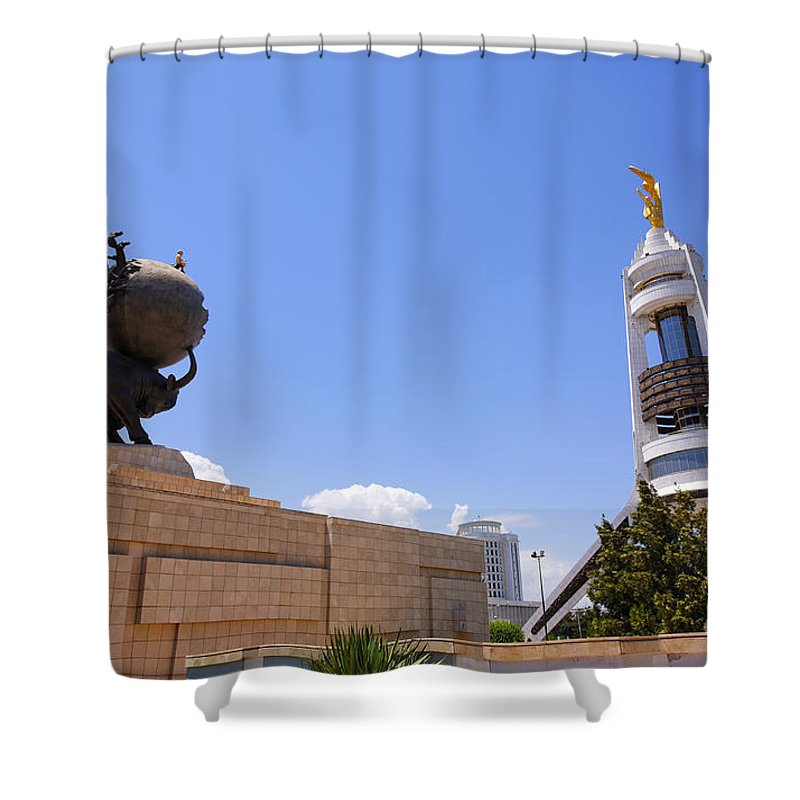 Turkmenistan Shower Curtain featuring the photograph The Earthquake Memorial Statue And The Arch Of Neutrality In Ashgabat Turkmenistan by Robert Preston