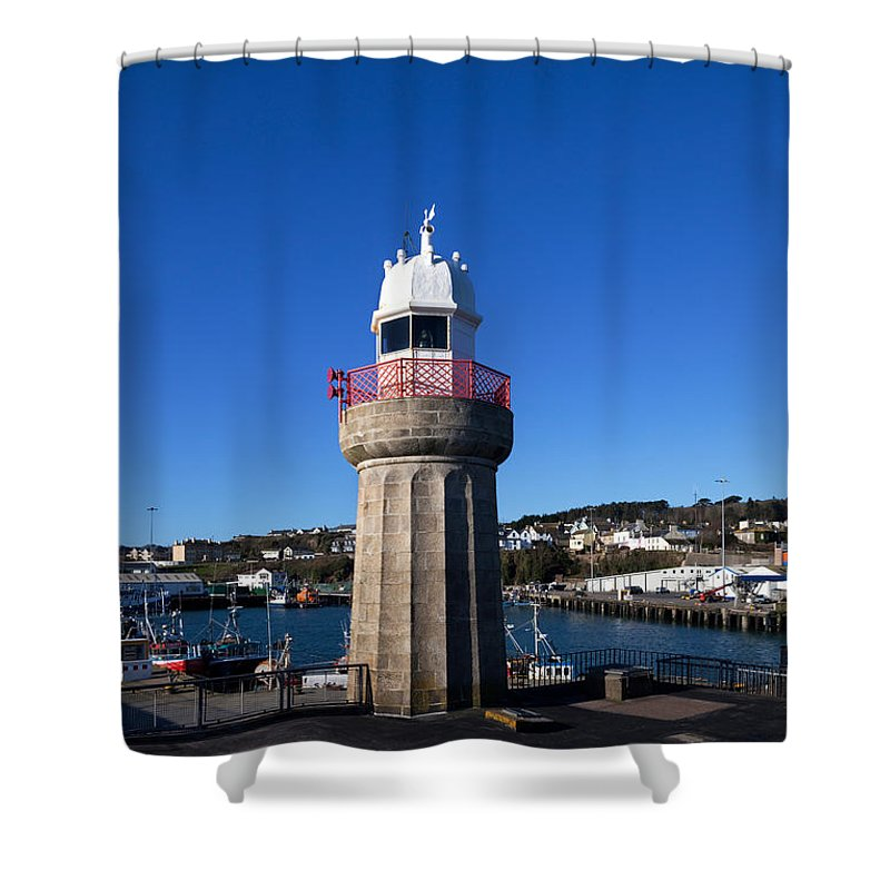 Photography Shower Curtain featuring the photograph The Lighthouse And Fishing Harbour by Panoramic Images