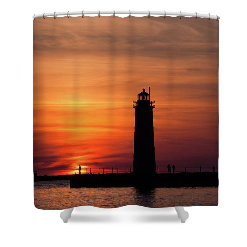 Nautical Shower Curtain featuring the photograph The Muskegon Lighthouse An A Lone Man Fishing by John Harmon
