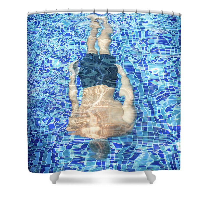 Underwater Shower Curtain featuring the photograph Top View Of Man Diving by Jasmin Merdan