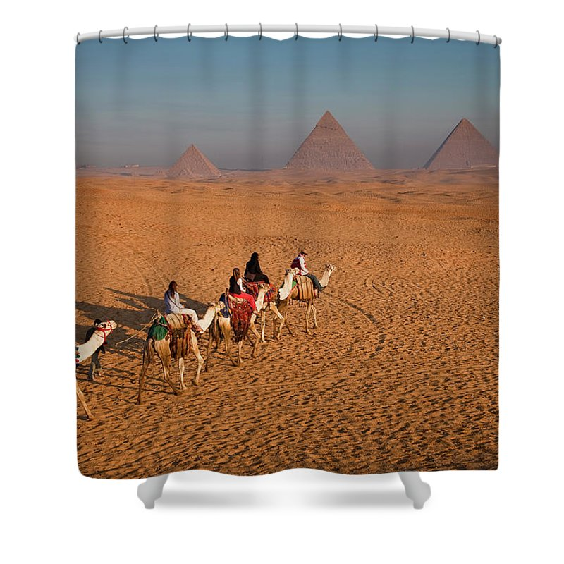 Working Animal Shower Curtain featuring the photograph Tourists On Camels & Pyramids Of Giza by Richard I'anson